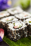 Vegetarian Roll. Vegetarian Maki Sushi -  Roll made of Cucumber, Bell Pepper, Salad Leaf and Cream Cheese inside. Sesame outside Royalty Free Stock Photo