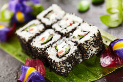 Vegetarian Roll. Vegetarian Maki Sushi -  Roll made of Cucumber, Bell Pepper, Salad Leaf and Cream Cheese inside. Sesame outside Royalty Free Stock Images