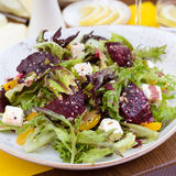 Vegetarian salad with beetroot in the restaurant. Salad of roasted beetroot, pear, spinach, hard cheese Stock Photography
