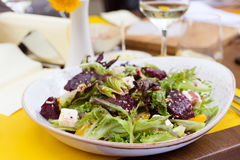 Vegetarian salad with beetroot in the restaurant. Salad of roasted beetroot, pear, spinach, hard cheese Stock Photos