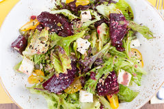 Vegetarian salad with beetroot in the restaurant. Salad of roasted beetroot, pear, spinach, hard cheese Royalty Free Stock Photography