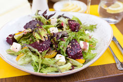 Vegetarian salad with beetroot in the restaurant. Salad of roasted beetroot, pear, spinach, hard cheese Stock Photo