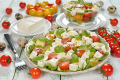 Vegetarian salad with cherry tomatoes, eggs and cheese Stock Photos