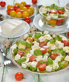 Vegetarian salad with cherry tomatoes, eggs and cheese Stock Photo