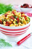 Vegetarian salad with chickpeas, dried tomatoes, capers and dill Royalty Free Stock Image