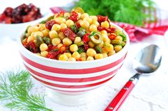 Vegetarian salad with chickpeas, dried tomatoes, capers and dill Stock Image