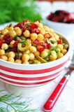 Vegetarian salad with chickpeas, dried tomatoes, capers and dill Stock Images