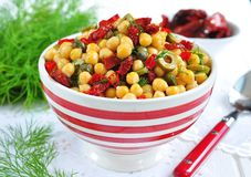 Vegetarian salad with chickpeas, dried tomatoes, capers and dill Royalty Free Stock Images