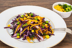 Vegetarian salad with corn, carrots and red cabbage Stock Photo