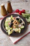 Vegetable salad with radish. Vegetarian salad of cucumbers, radish  and chickpeas Royalty Free Stock Photo