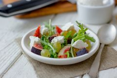 Vegetarian salad with figs and goar cheese. stock images