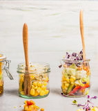 Vegetarian salad in glass jar. Healthy lunch in jar on  light rustic kitchen background. Stock Photos