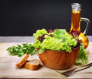 Vegetarian salad and olive oil Royalty Free Stock Images