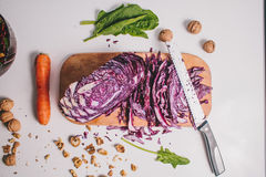 Vegetarian salad with purple cabbage.carrot.lay flat. Royalty Free Stock Photography