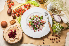 Vegetarian salad the restaurant. Vegetarian salad with cranberries onions tomatoes arugula radish nuts Royalty Free Stock Image