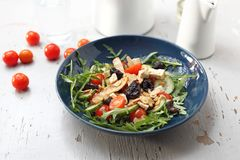 Vegetarian salad with tofu, cherry tomatoes, arugula, cucumber stock photography