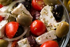 Vegetarian salad with tomatoes, feta, olives and fresh vegetable Stock Image