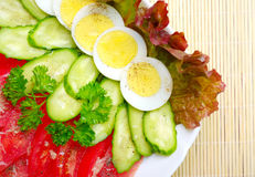 Vegetarian salad on wooden mat Stock Image