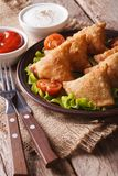 Vegetarian samosas on a plate with tomatoes and lettuce vertical Stock Photo