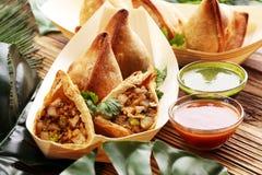 Vegetarian samsa or samosas.Indian special traditional street food punjabi samosa or Coxinha, Croquete and other Fried Brazilian royalty free stock photos