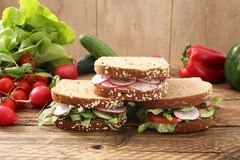 Vegetarian sandwich. On rustic wooden table backgroundnn royalty free stock photography