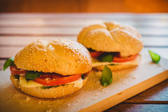 Vegetarian sandwich. On a wooden plate and table Stock Photo