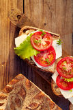 Vegetarian sandwiches with addition of cheese, tomato and lettuce Royalty Free Stock Photography
