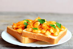 Vegetarian sandwiches with bean. Open sandwiches with bread, stewed white beans and vegetables on a plate. Closeup. Vegetarian sandwiches recipe. Stewed white stock images