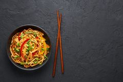Free Vegetarian Schezwan Noodles Or Vegetable Hakka Noodles Or Chow Mein In Black Bowl At Dark Background. Indo-chinese Cuisine Hot Royalty Free Stock Photo - 159221465