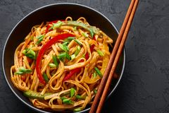 Free Vegetarian Schezwan Noodles Or Vegetable Hakka Noodles Or Chow Mein In Black Bowl At Dark Background. Schezwan Noodles Is Indo- Stock Image - 159221461