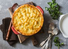 Vegetarian shepherd`s pie. Potatoes, lentils and seasonal garden vegetables casserole. Autumn vegetarian lunch stock photos