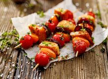 Vegetarian skewers with halloumi cheese, cherry tomatoes, red onion and fresh herbs royalty free stock photography