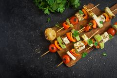 Vegetarian skewers with halloumi cheese stock photo