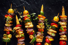 Vegetarian skewers with halloumi cheese and mixed vegetables on black background. Top view Stock Photography