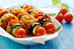 Vegetarian skewers  with organic vegetables on a white plate Royalty Free Stock Photos