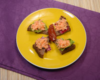 Vegetarian Snack. Celery and Carrot salad with slices of whole wheat bread on a yellow plate Stock Photos