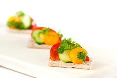 Vegetarian snack on crispbread Stock Images