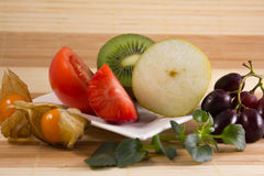 Vegetarian snack with different fruits Stock Photos