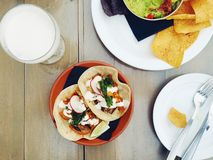 Vegetarian soft tacos with chips and guacamole and a cocktail Royalty Free Stock Image