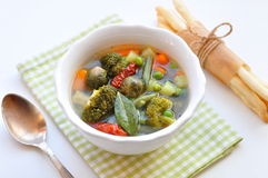 Vegetarian soup with a broccoli, Brussels cabbage, carrot, peas and olive oil Royalty Free Stock Photography