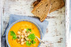 Vegetarian Soup from carrots, tomatoes, brocolli and chickpeas. Light background Royalty Free Stock Image
