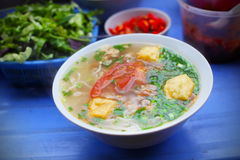 Vegetarian soup with fried tofu, tomato and scallion stock photo