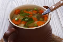 Vegetarian soup in a pot on a napkin Stock Photo