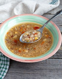 Vegetarian soup with quinoa, rice red, yellow lentils, corn, pep Royalty Free Stock Photos