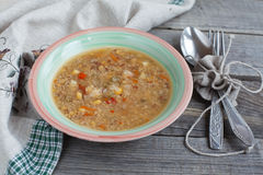 Vegetarian soup with quinoa, rice red, yellow lentils, corn, pep Stock Photo