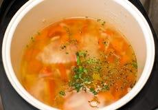 Vegetarian soup in the slow cooker. Vegetarian vegetable soup in a slow cooker Stock Photo