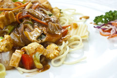 Vegetarian spaghetti in tomatoes sauce in thailand. Vegetarian food : spaghetti in tomatoes sauce with mushroom, tofu, vegetables Stock Photos