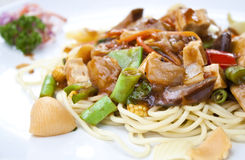 Vegetarian spaghetti in tomatoes sauce in thailand. Vegetarian food : spaghetti in tomatoes sauce with mushroom, tofu and vegetable Stock Images