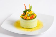 Vegetarian starter. A cucumber vegetarian starter with olive oil on a white plate Royalty Free Stock Image