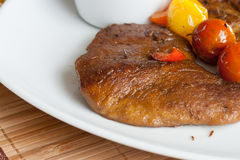 Vegetarian steak made from vegan meat seitan, with cherry tomatoes Stock Image